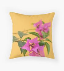 Bougainvillea against a yellow wall Throw Pillow