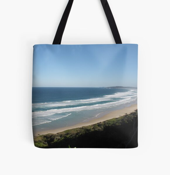 A crowded beach at Byron bay NSW. All Over Print Tote Bag