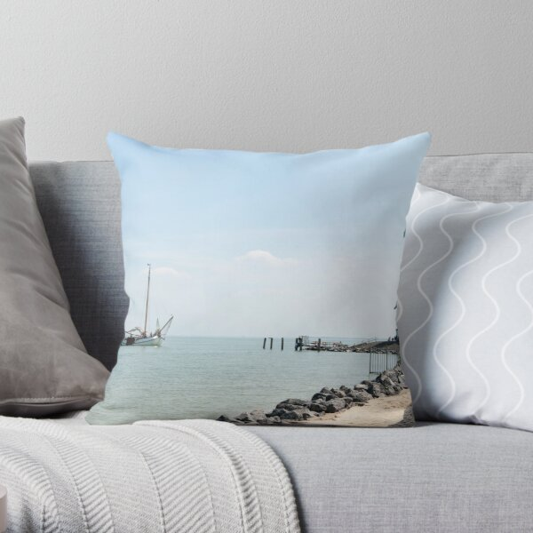 Sailing boat arriving at the lighthouse Throw Pillow