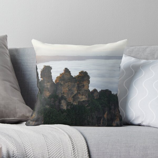 Three sisters view a misty valley Throw Pillow