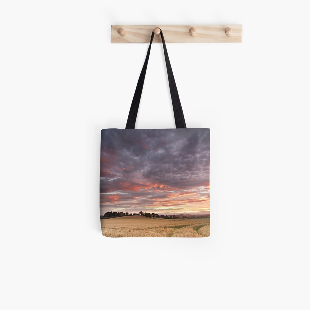 Field with a bump Tote Bag