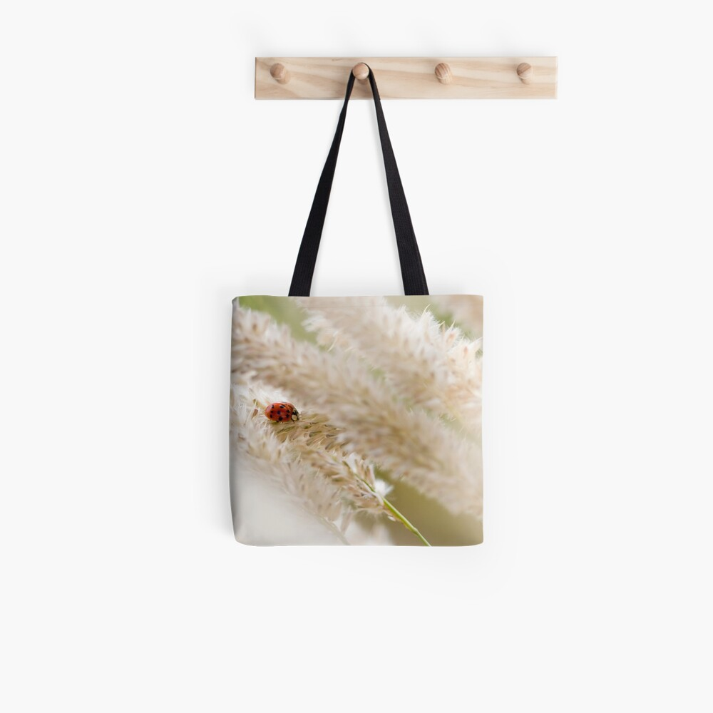 Ladybird on a Cloud of Seeds Tote Bag