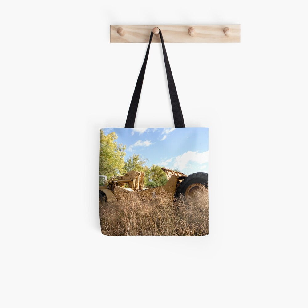 Land Grader parked in the grass Tote Bag