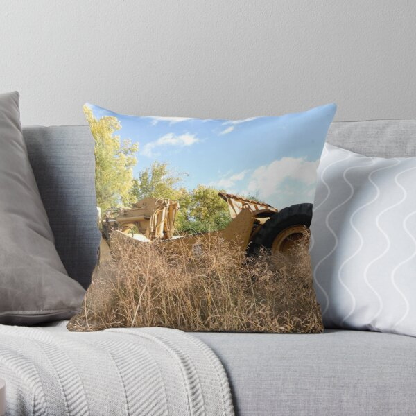 Land Grader parked in the grass Throw Pillow
