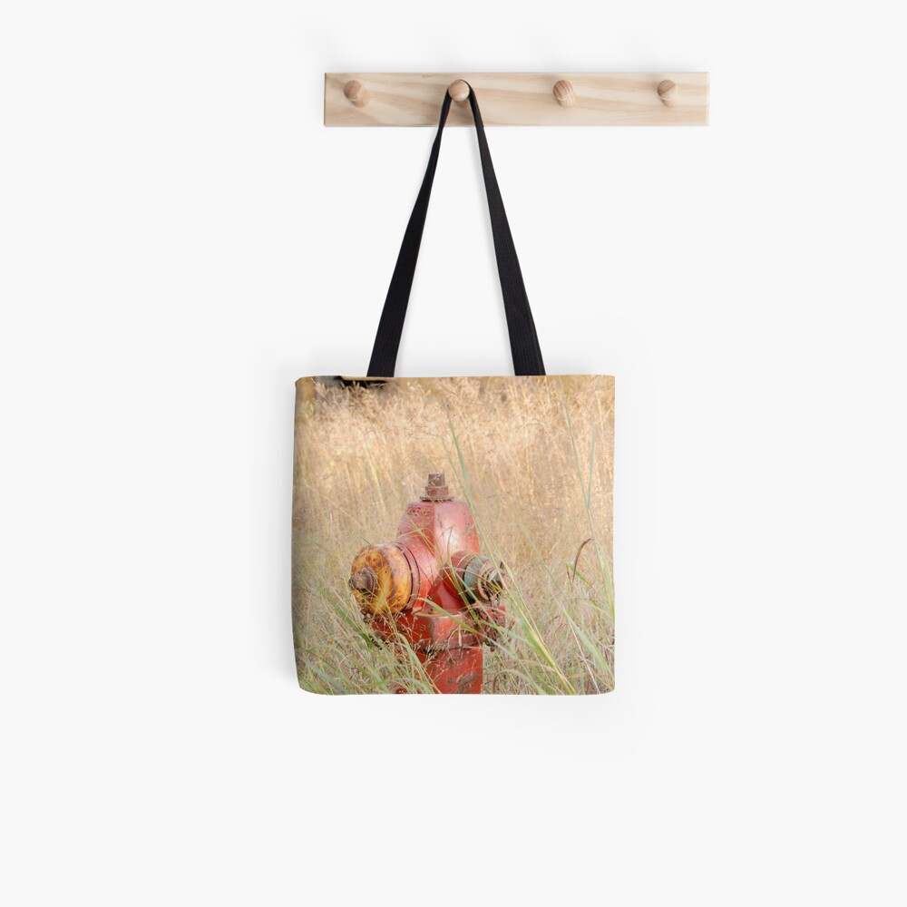 Fire Hydrent in tall grass Tote Bag