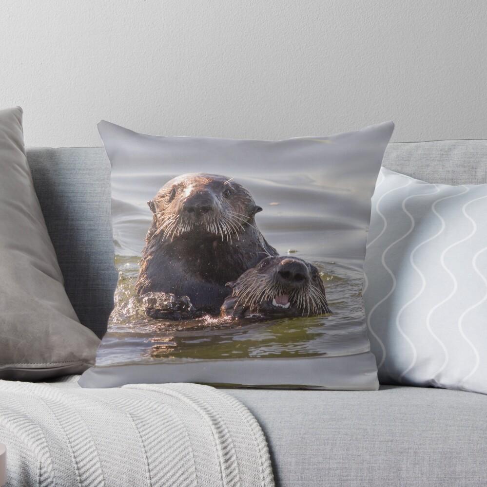 Sea otters of California Throw Pillow