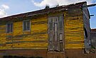 Old Yellow wooden house, Cienfuegos, Cuba by David Carton