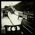 Benches on the sea front - Sheringham by Richard Flint
