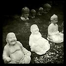 Buddha and other statues, Heacham, Norfolk, UK by Richard Flint