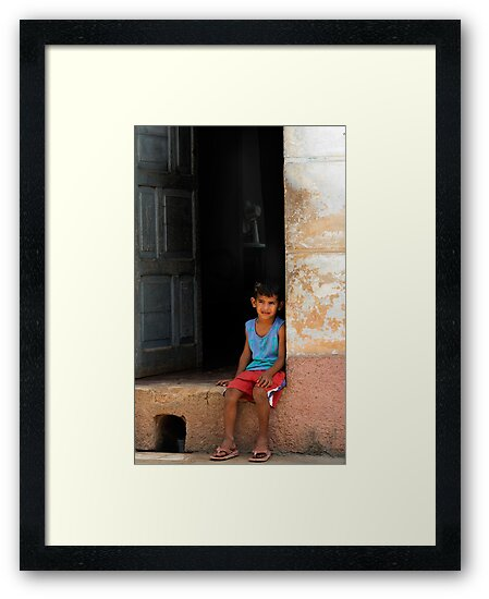 Cuban boy sitting on door step, Trinidad, Cuba by David Carton