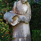 Statue in a garden in Cascais by julie08
