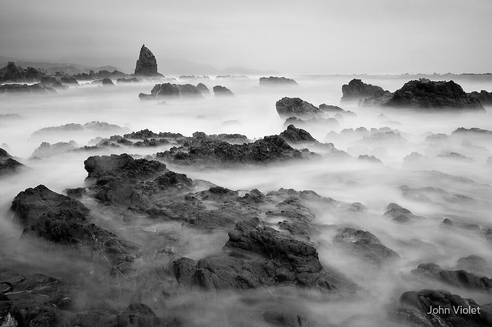Stormy Rocks by John Violet