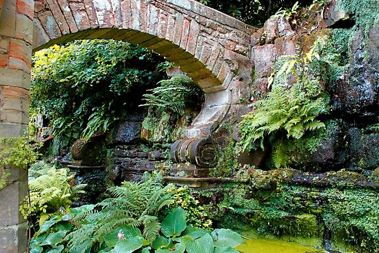 A stone arch decorates the garden by John Wallace
