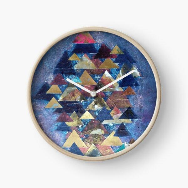 Gold and mauve triangles on deep indigo background Clock