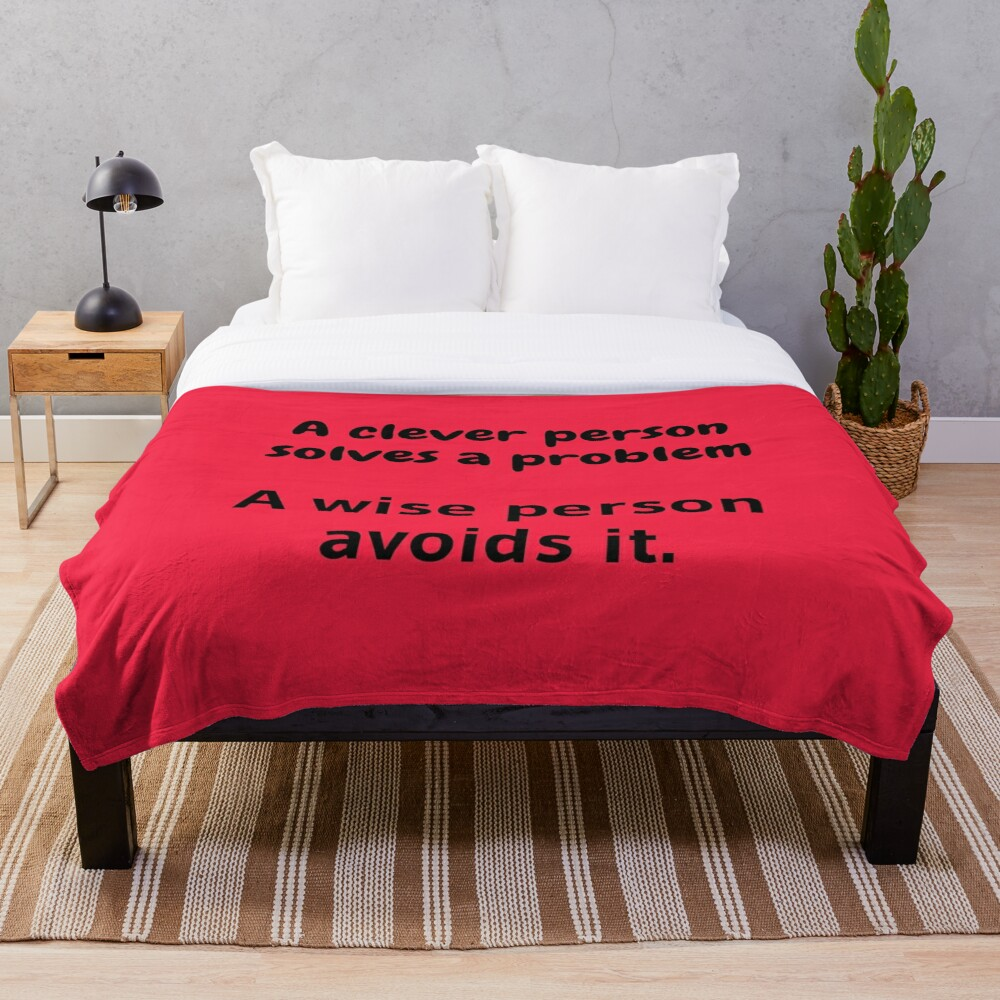 A clever person solves a problem, A wise person avoids it. Throw Blanket