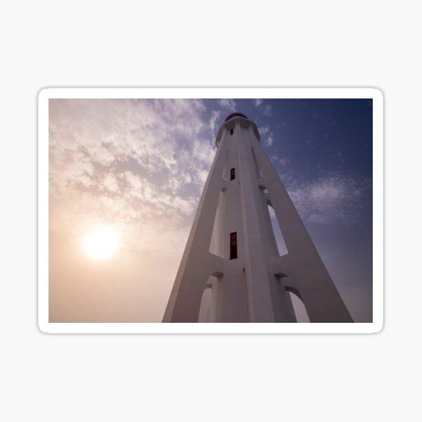 Modern lighthouse with fading sun Sticker