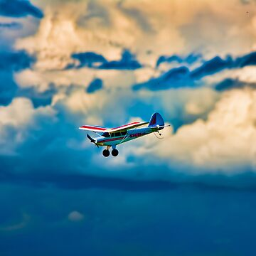 RC plane in storm clouds by eadnams