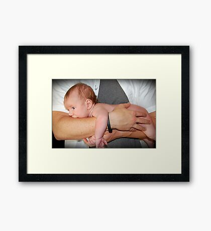 In daddy's hands.. Framed Print