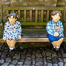 Dutch Boy and Girl on Bench in Veere, Netherlands by Robert Kelch, M.D.