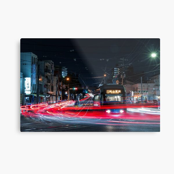 Japanese tramline and light trails in urban area at night Metal Print