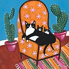Tuxedo Mom and Kittens in a Chair by Ryan Conners