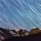 Stars Raining Down On The Colorado Indian Peaks by Bo Insogna