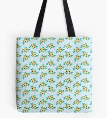 Yellow flower clusters floral pattern on blue Tote Bag
