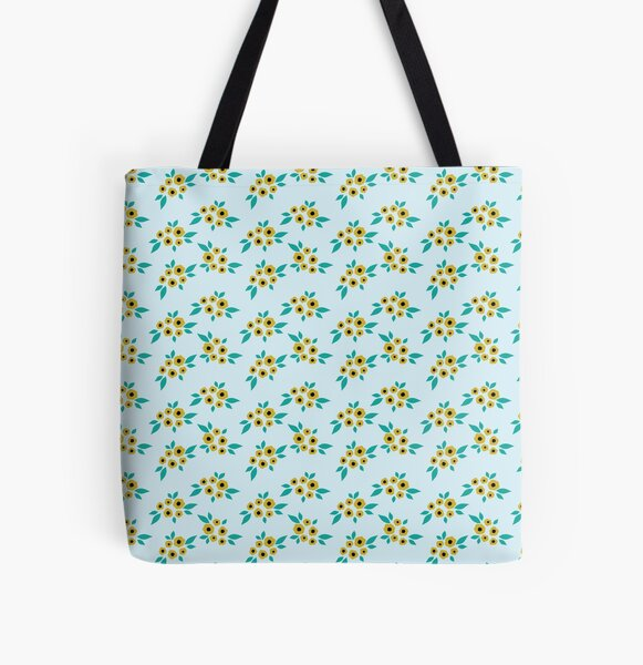 Yellow flower clusters floral pattern on blue All Over Print Tote Bag