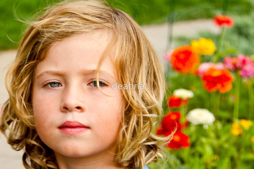 A boy in a flower field by deahna