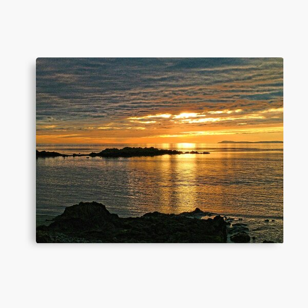 Sunset over Big Scone Rock and Islay from Machrihanish Canvas Print