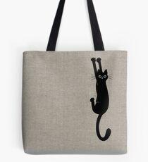 Schwarze Katze, die an hält Tote Bag