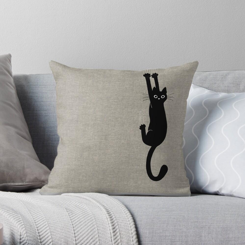 Black Cat Holding On Throw Pillow