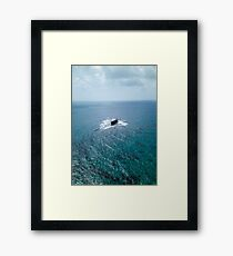 A shipwreck in the middle of the sea Framed Print