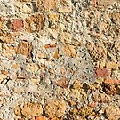 Close up view of an aged textured plastered stone wall by Sergey Orlov