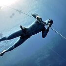 Freediver makes preparation dive near the safety line by Sergey Orlov