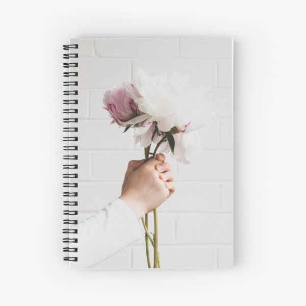Child's hands holding beautiful peonies Spiral Notebook