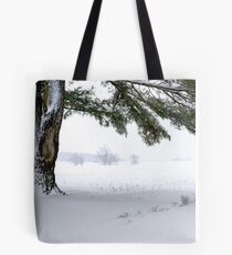 Pine Tree Framing Snow Scene Tote Bag