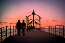 A Stroll Along Sunset Pier by Ray Warren
