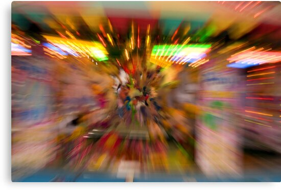 Slow shutter speed zoom burst effect at the Fair by David Carton
