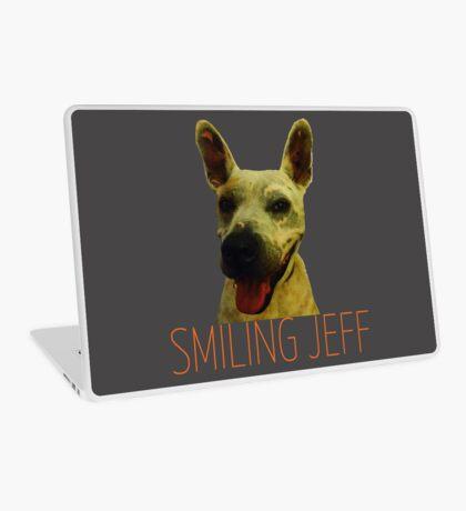 Smiling Jeff with Orange Text Laptop Skin