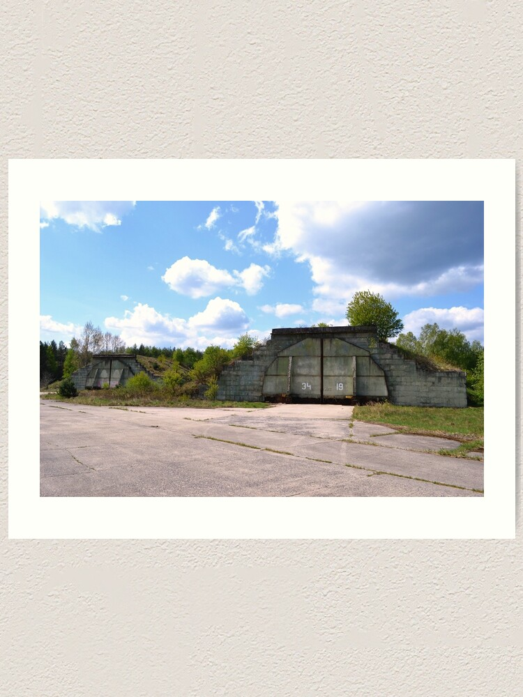 Alternate view of Fortified airplane hangars in former military area Art Print