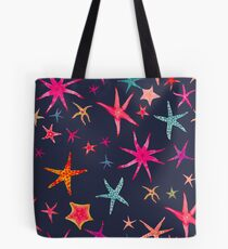 colorful watercolor starfish on navy ground Tote Bag