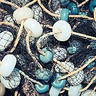 Mixed up fishnet with rope and lot of buoys by Alexander Nedviga