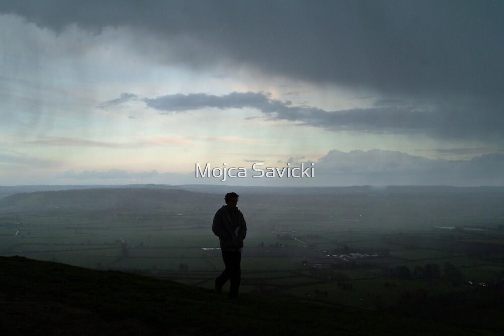 Cold, windy storm over Glastonbury Tor by Mojca Savicki