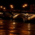 Stone bridge and waves on river by night by shkyo30