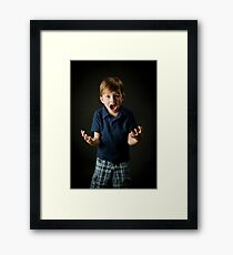Young boy screaming with emotion Framed Print