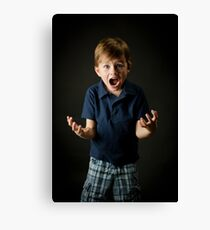 Young boy screaming with emotion Canvas Print