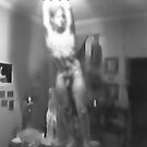 Boy on Table, swinging from Light Bulb by strykermeyer