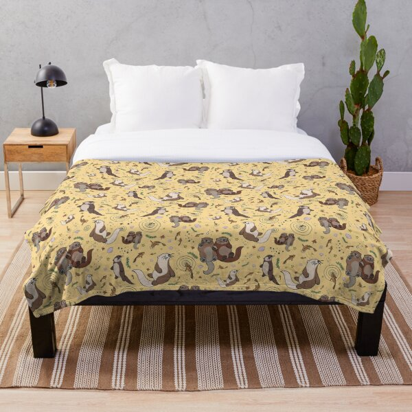 Otters in Yellow Throw Blanket