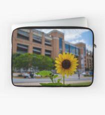 Sunflower in front of Darrell K Royal - Texas Memorial Stadium Laptop Sleeve